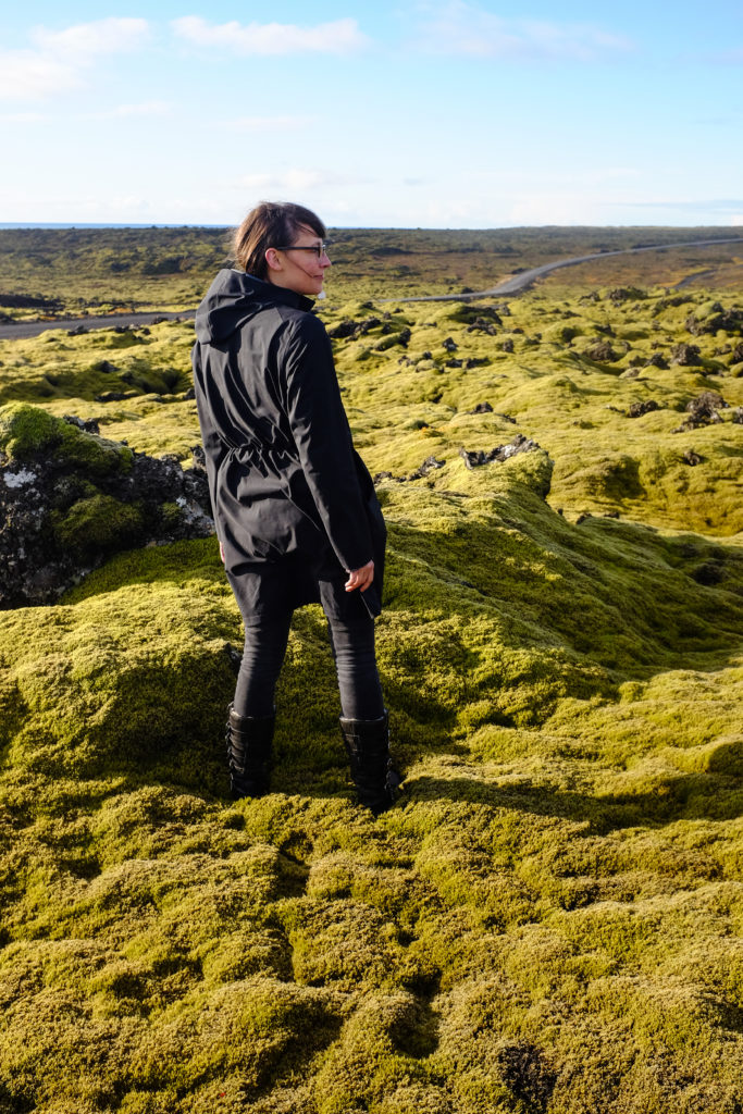 Girl in Moss covered lava fied