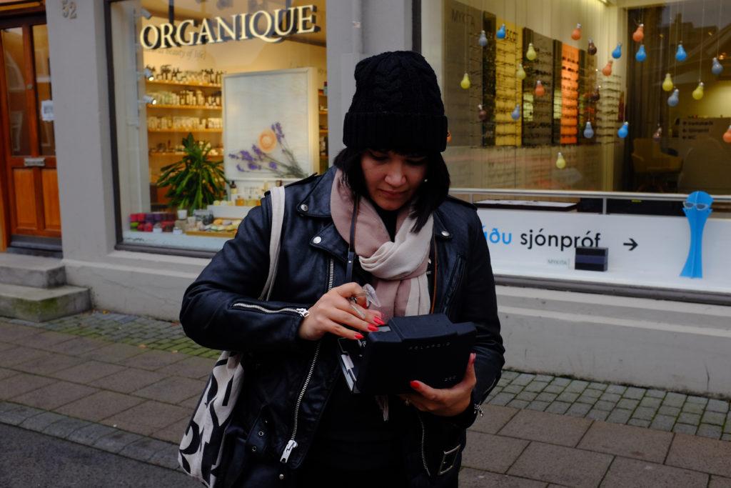 Girl in beanie outside sightseeing in reykjavik schott leather