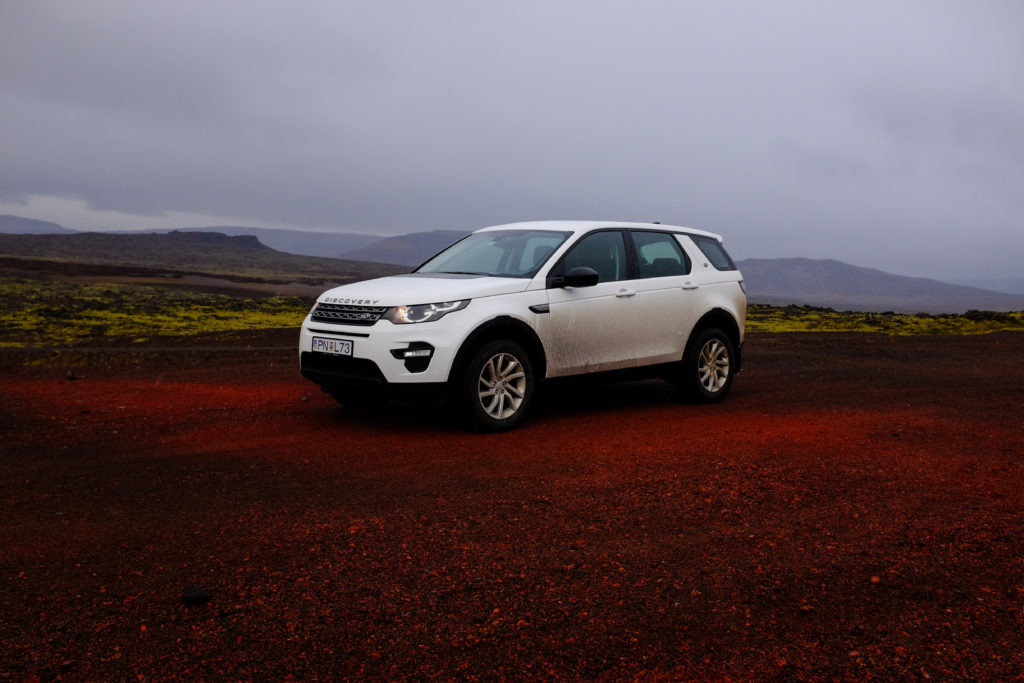 White Land Rover in Lava Field Iceland